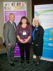 Older Adults Centres' Assocation of Ontario's Sue Hesjedahl with the Minister Responsible for Seniors' Mario Sergio and Alzheimer Society of Ontario CEO Gale Carey